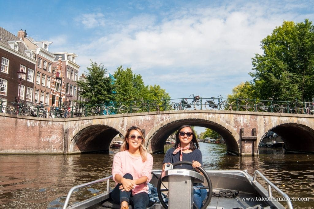 If you're in Amsterdam and want to ride around the canals, avoid the mistake I made of going on a tourist trap canal cruise! Rent your own boat with Mokumboot instead. Click through to see which company I like the best after having tried three, and which route I like the best.