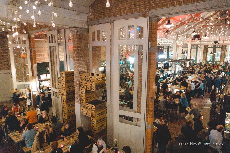 de foodhallen amsterdam gluten vrij gluten free people crowded bar scene