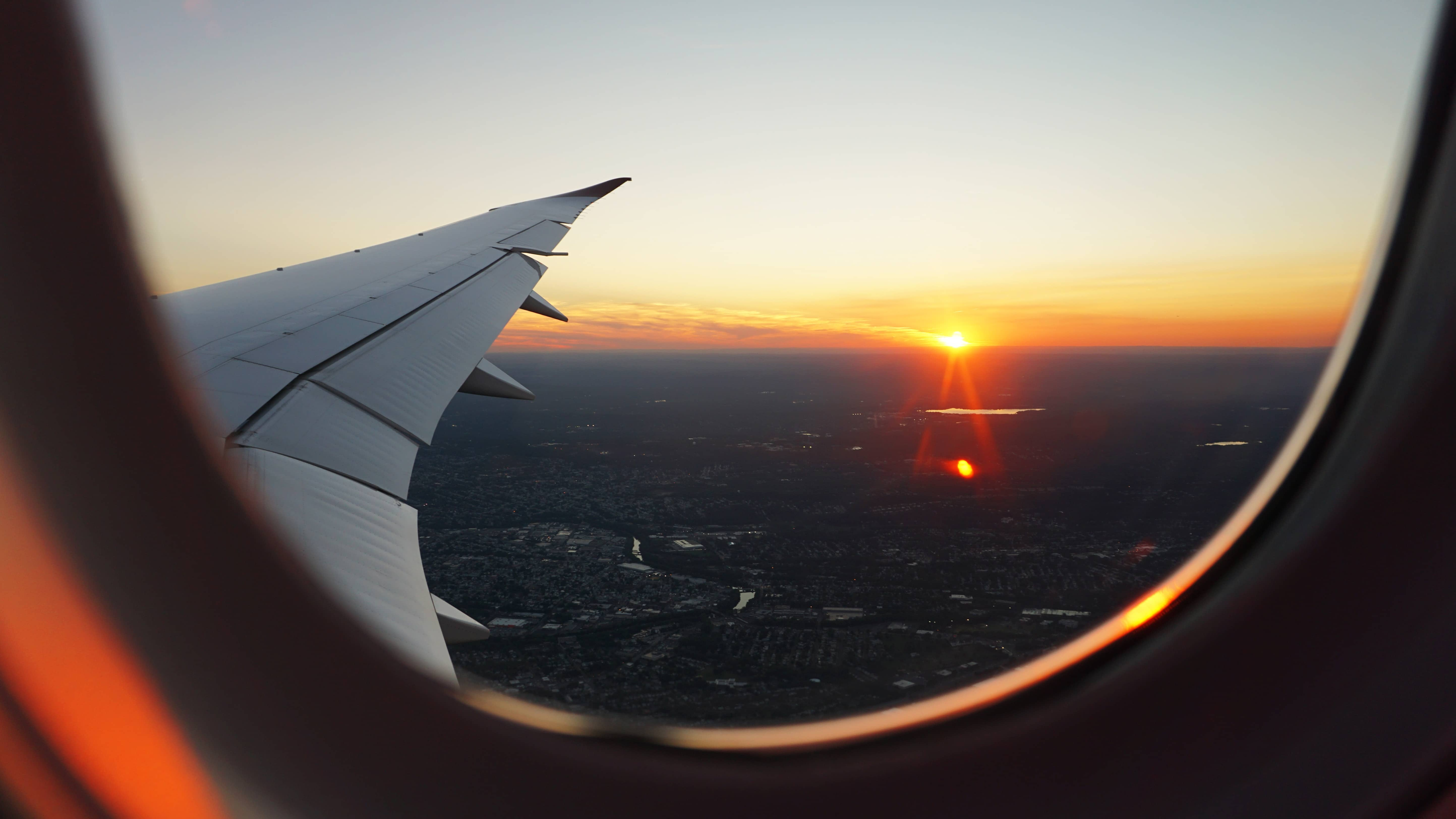sunset flight window plane fromlusttilldawn.com from lust till dawn what is airbnb