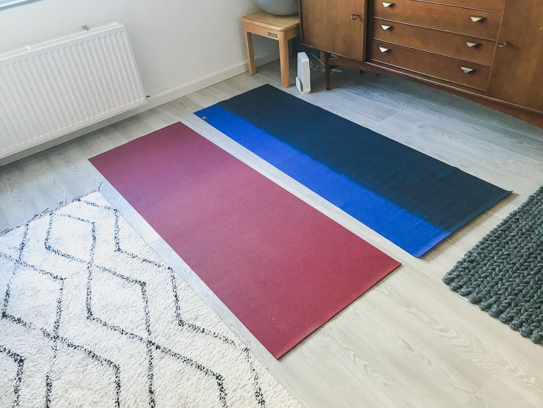 Manduka travel mat side by side with a regular yoga mat