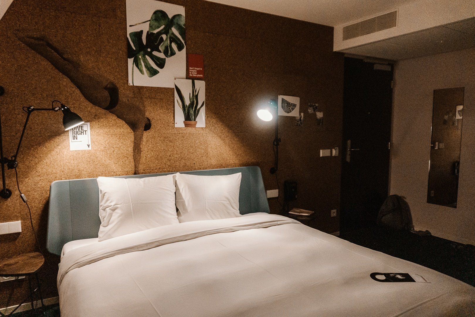 A picture of the bed and decor in The Tire Station hotel, located in Oud-West.