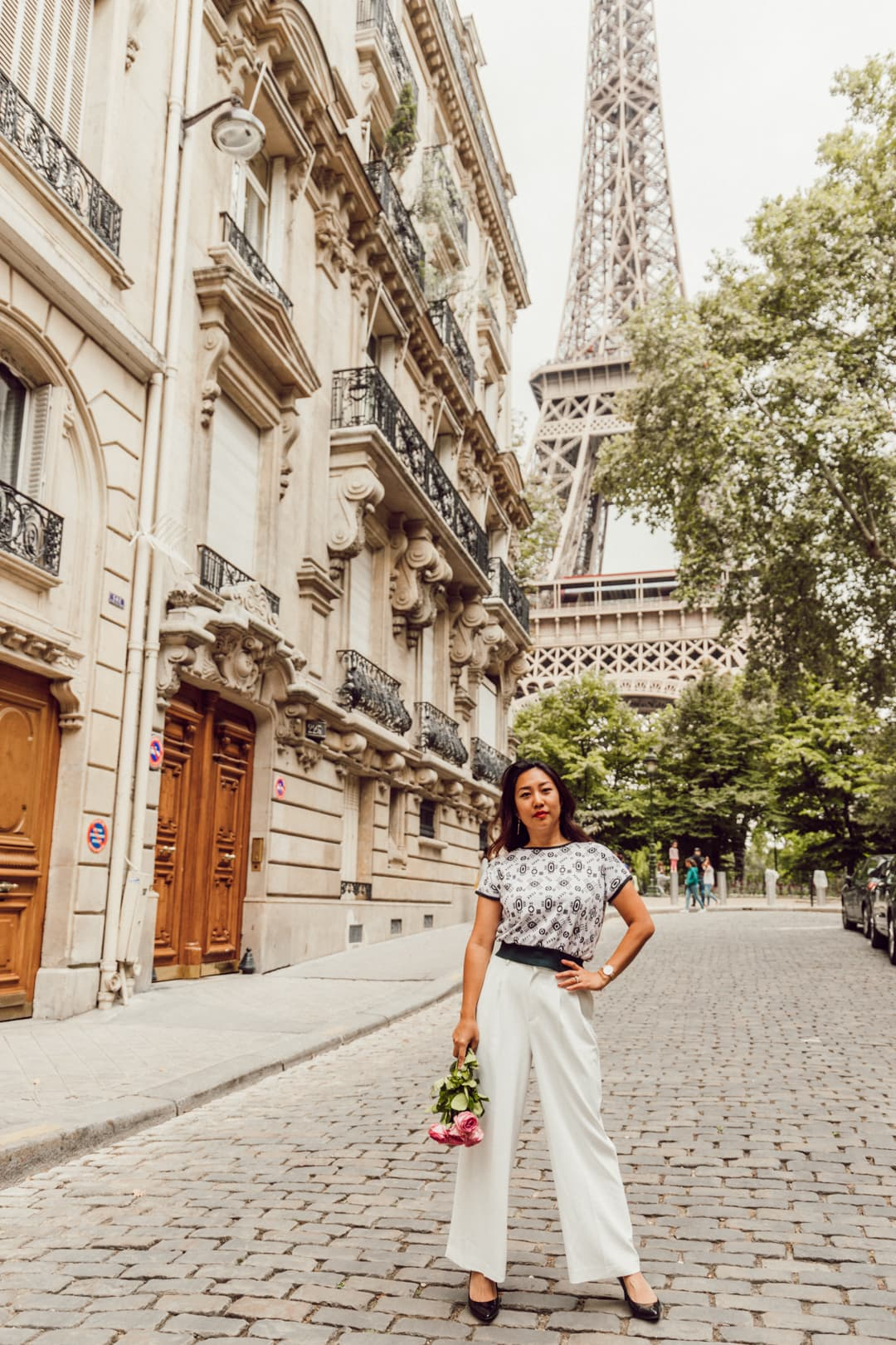 Travel blogger Sarah Kim posing in front of the Eiffel Tower | Off the Beaten Path Paris Guide by www.fromlusttilldawn.com