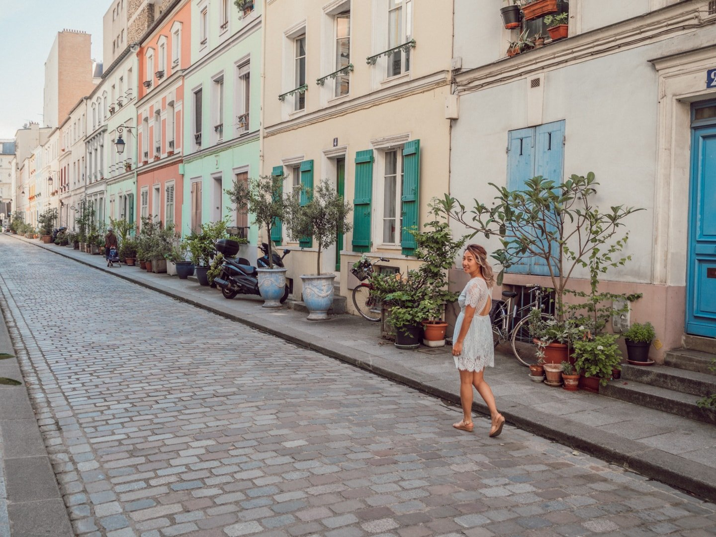Travel blogger Sarah Kim walks down Rue Cremieux in Paris France | Off the Beaten Path Paris Guide by www.fromlusttilldawn.com