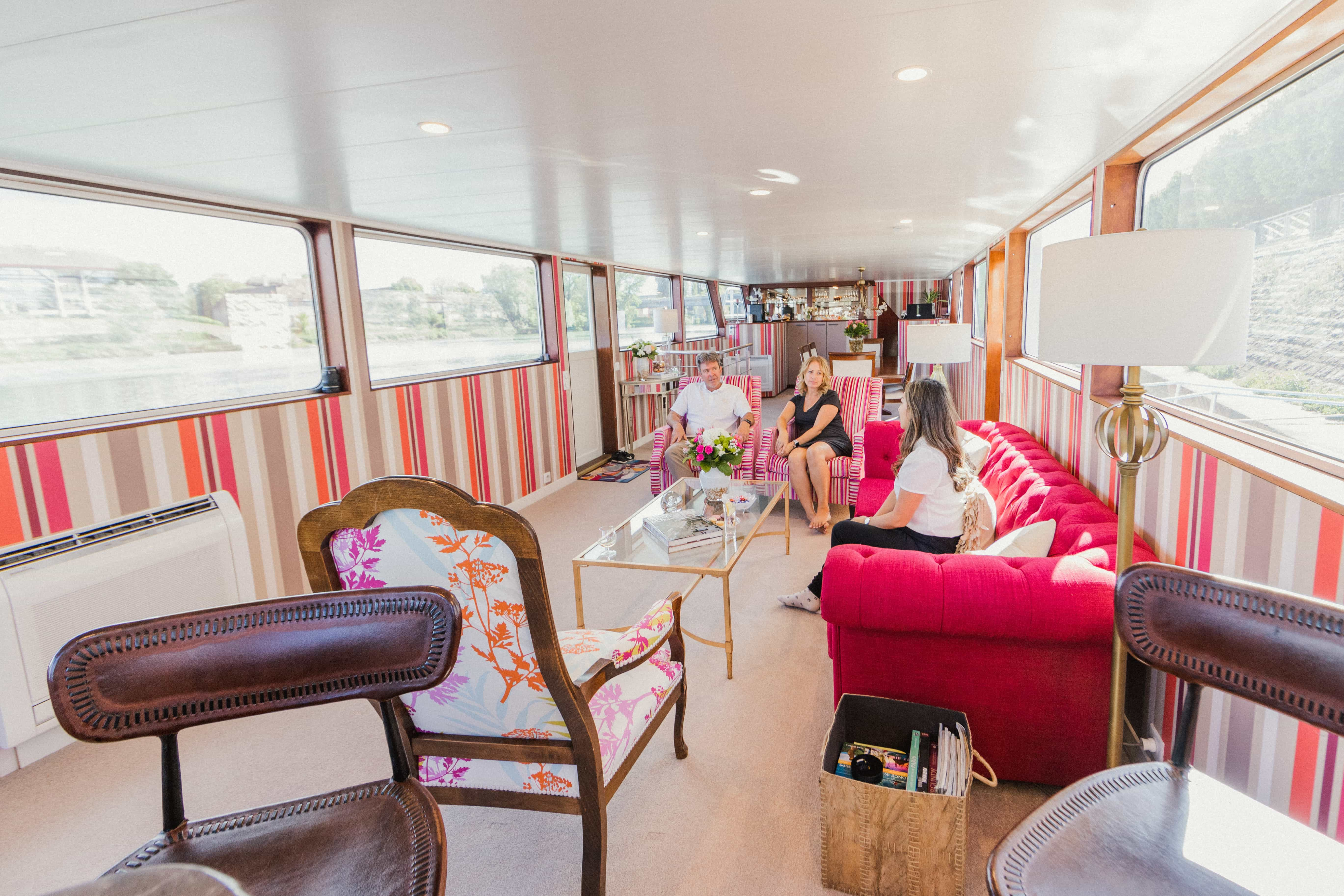 Sitting in the salon of a luxury barge cruise on the canals of France with owners of the Grand Victoria Cruises