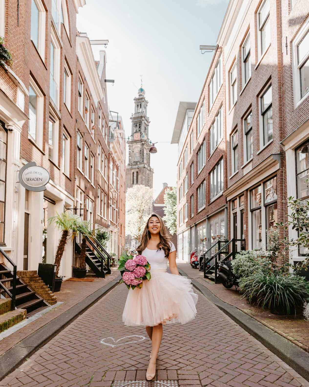This street in Westerkerk with the church in the background is one of beautiful places in Amsterdam.