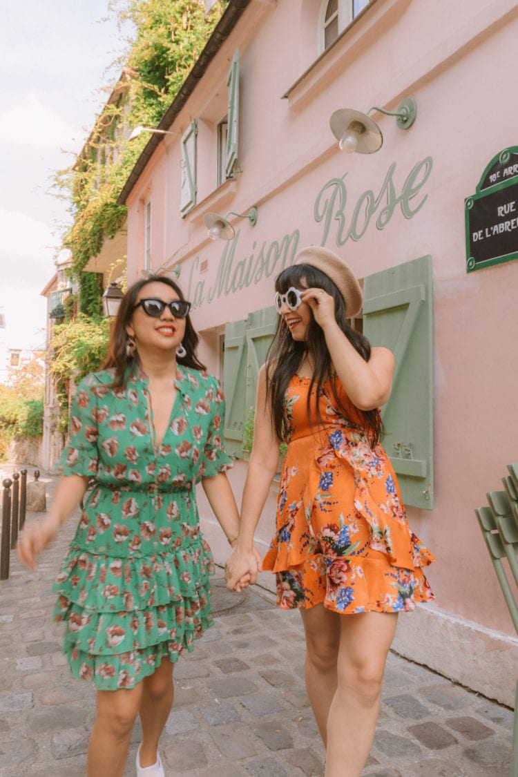 two girls in montmartre paris wearing bright colored dresses in front of la maison rose paris | www.fromlusttilldawn.com