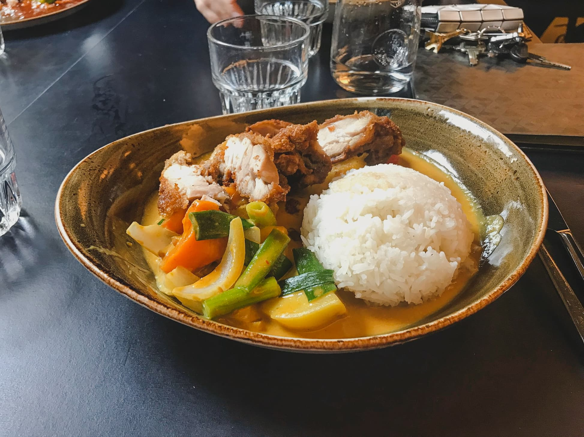 Speaking of where to eat in Berlin, the crispy duck with vegetables covered in a curry sauce is the way to go
