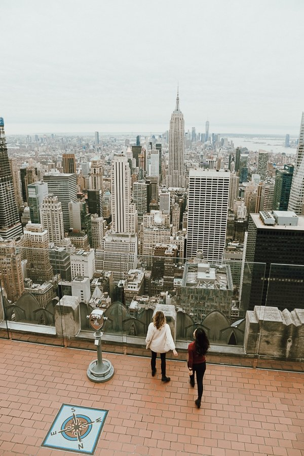 two woman overlooking manhattan from the top of the rock, one of the most instagrammable places in nyc