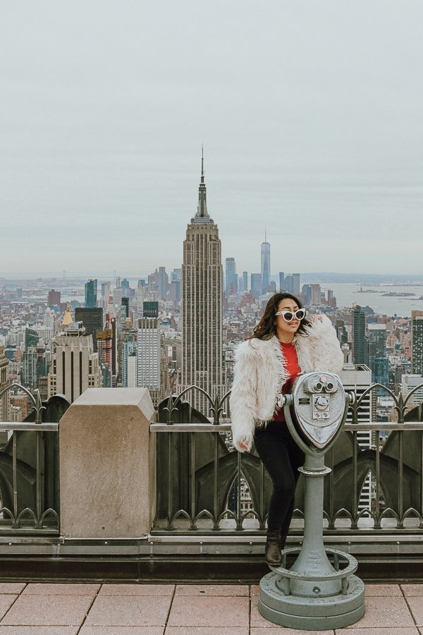 one woman overlooking manhattan from the top of the rock, one of the most instagrammable places in nyc