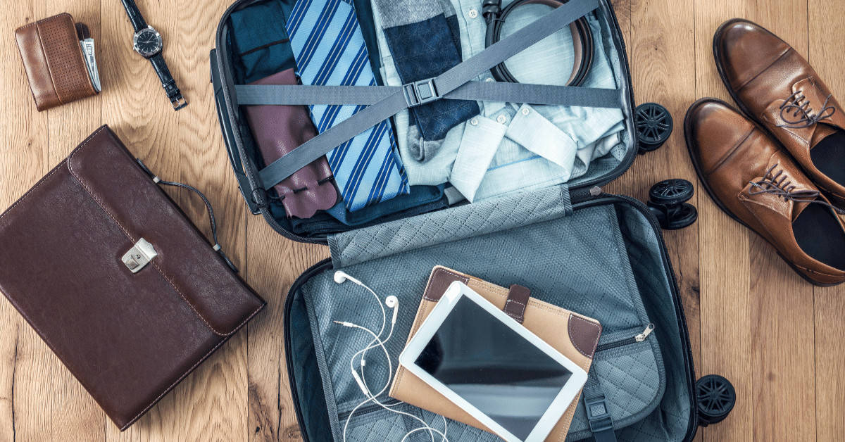 A tablet is a great addition to your travel must have list! It can be easily packed into your luggage, as seen here, laying on top of an open bag.