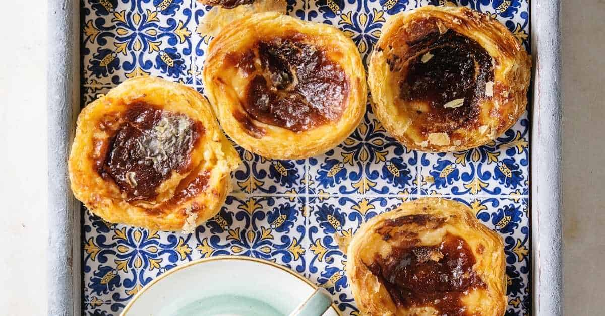 Encouraging people to try Pastéis de Nata in Lisbon is one of best Lisbon travel tips.
